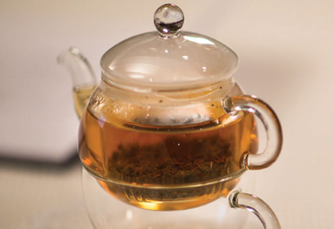 Glass Teapot filled with Tea