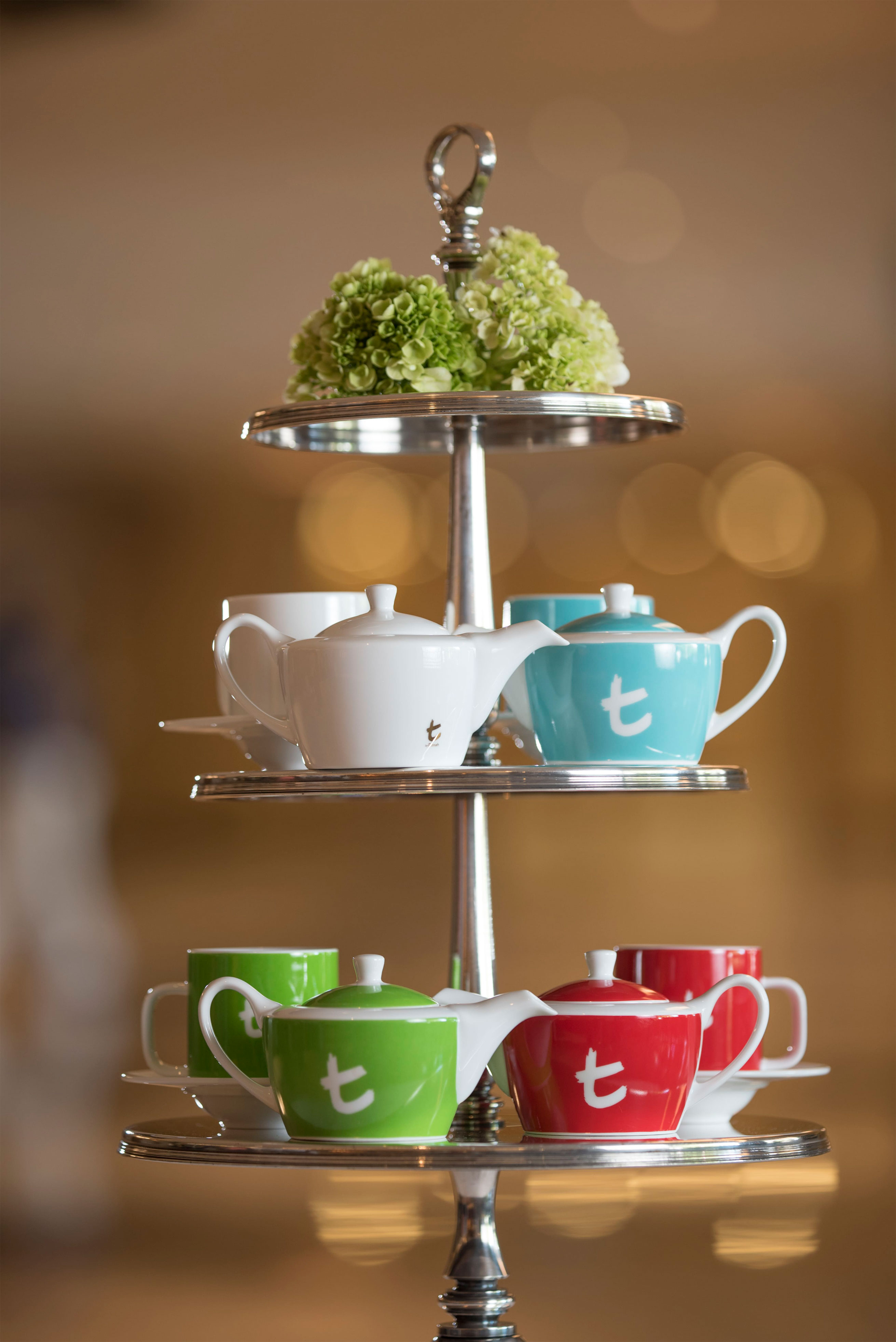 The lively and vibrant tea pots and cups features a contemporary tea presentation that invites guests to a delightful experience