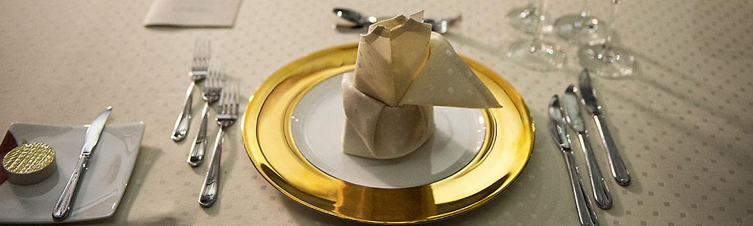 Prepared Gold Coloured Plate with other Tableware